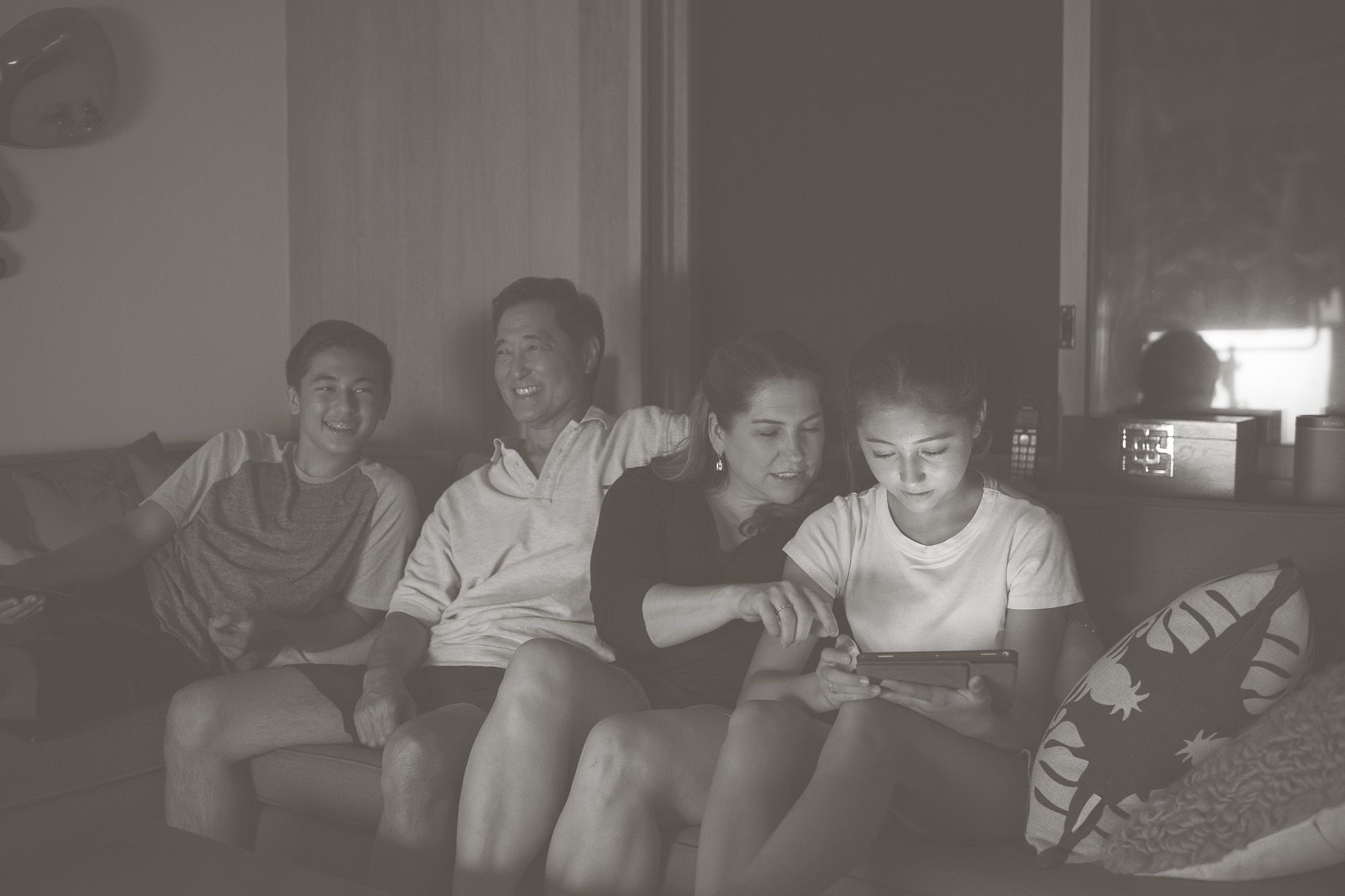 family relaxing on couch